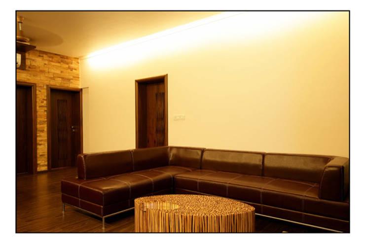 Konnur site:  Living room by CK Interiors Pvt Ltd