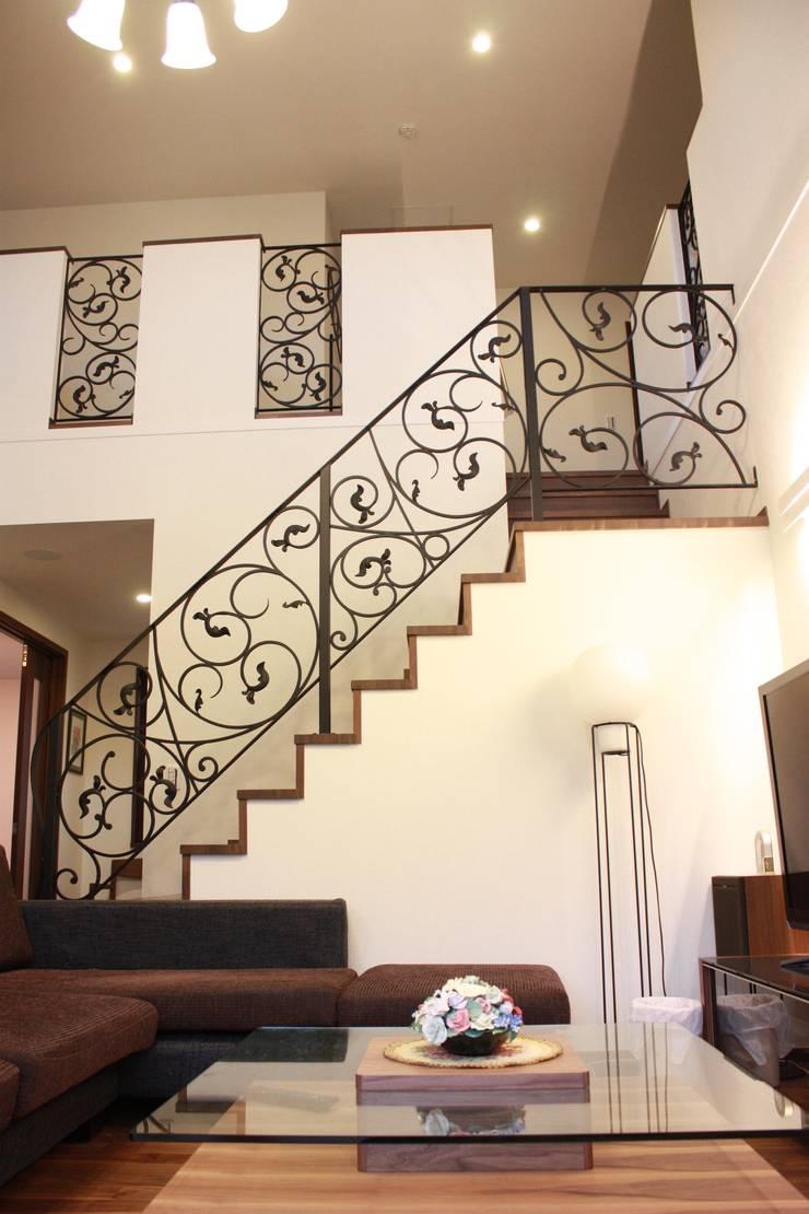 階段フェンス・室内フェンス: 株式会社ディオが手掛けた玄関&廊下&階段です。