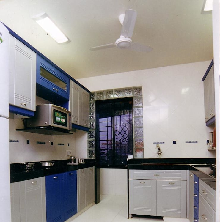 Apartment:  Kitchen by NAMAN INTERIORS - Turnkey Interior Contractors