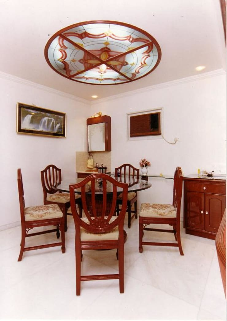 Apartment:  Dining room by NAMAN INTERIORS - Turnkey Interior Contractors