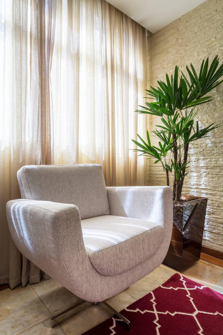 Apartamento Nova Suíça: Salas de estar  por Melina Mundim   Design de Interiores