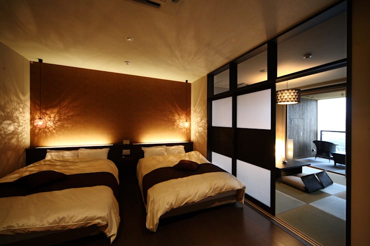 和洋室タイプ: 株式会社井上輝美建築事務所+都市開発研究所  aim.design studioが手掛けたホテルです。