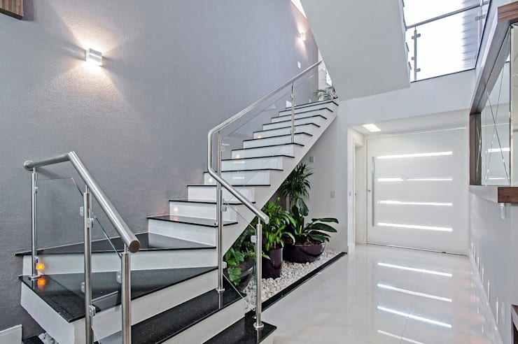 Pasillos y vestíbulos de estilo  por Patrícia Azoni Arquitetura + Arte & Design