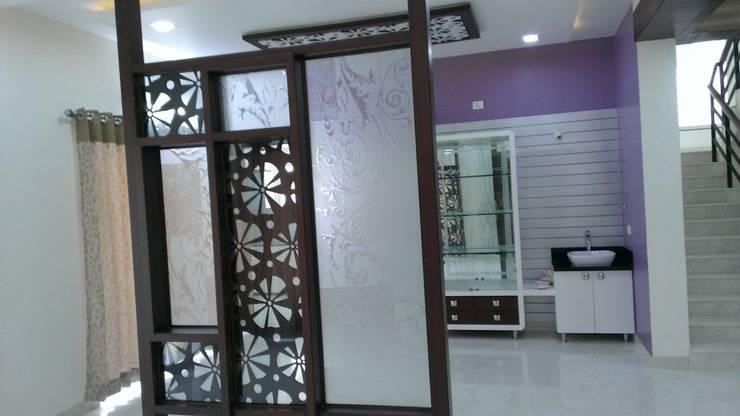Apartment: modern Living room by bhavani&co
