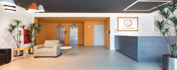 CWI Software – São Leopoldo: Espaços comerciais  por Mundstock Arquitetura,Moderno