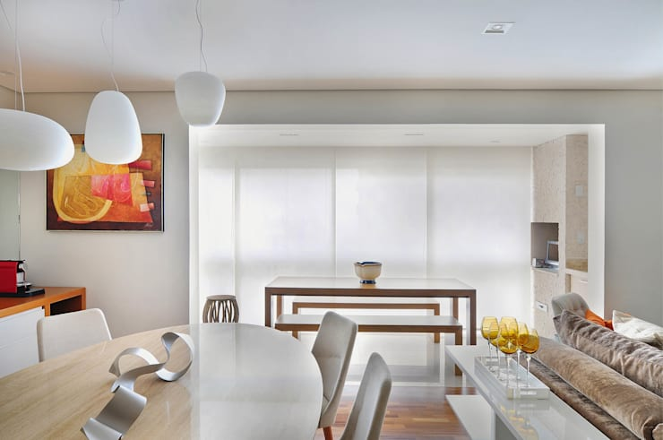 Apto Xavier de Almeida: Salas de jantar modernas por Madi Arquitetura e Design