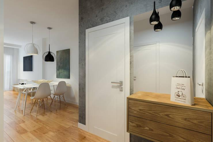 Nowoczesny apartament: styl , w kategorii Korytarz, przedpokój zaprojektowany przez Pracownia Aranżacji Wnętrz 'O-Kreślarnia'