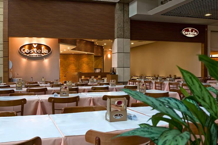 Costela Premium Ribs - Shopping Nações Unidas: Espaços gastronômicos  por Atmosfera Arquitetura Sociedade Ltda