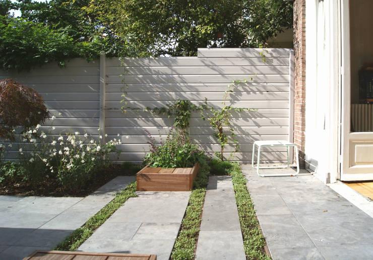 Familietuin met kookeiland: moderne Tuin door House of Green