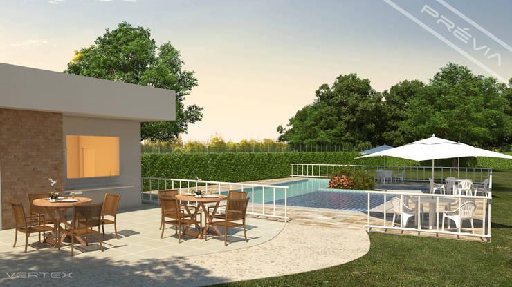 Área da piscina do condomínio.: Piscinas  por Studio HG Arquitetura,