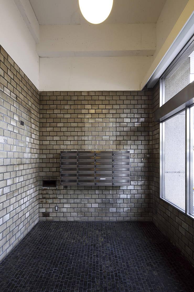 Jimukino-Ueda - ジムキノウエダ -: 株式会社アーキネット京都1級建築士事務所が手掛けた廊下 & 玄関です。,