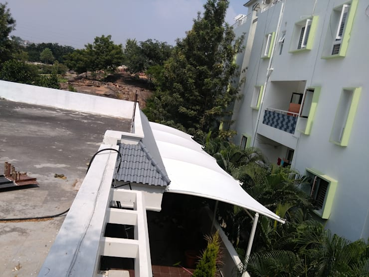 Mr.Sudharshan Reddy's residence:  Terrace by Fabritech India,Modern