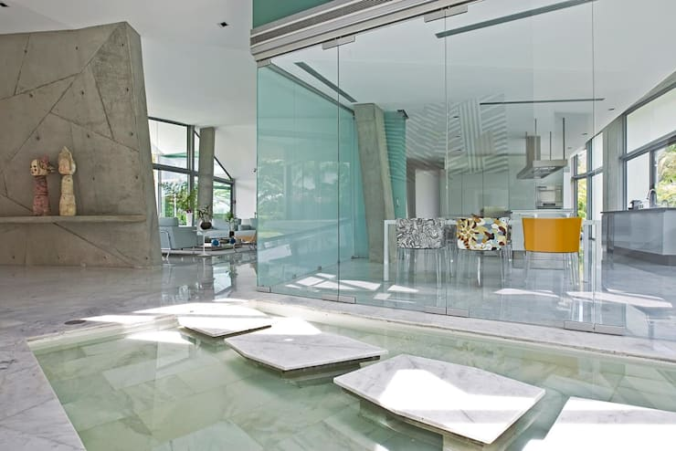 Casa AG: Salas / recibidores de estilo  por oda - oficina de arquitectura