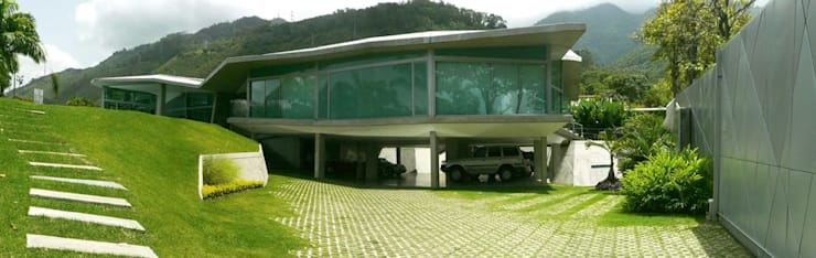 Casa AG: Jardines de estilo  por oda - oficina de arquitectura