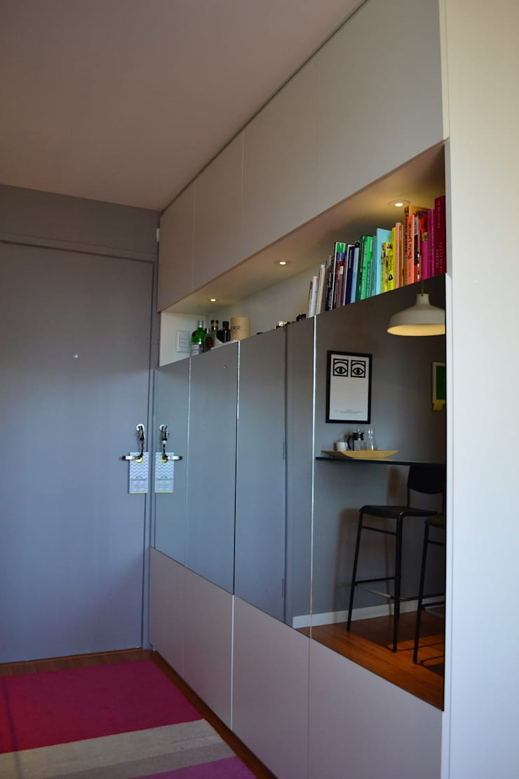 Studio SV: Sala de estar  por UNIO Arquitetura,