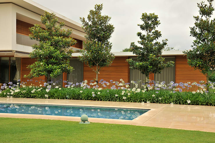 Residência VD: Piscinas  por isis chaulon arquitetura