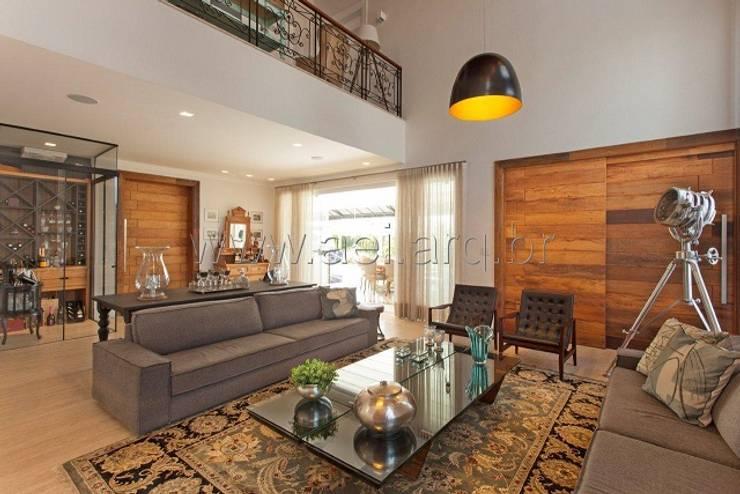 Sala de Estar: Salas de estar  por aei arquitetura e interiores,