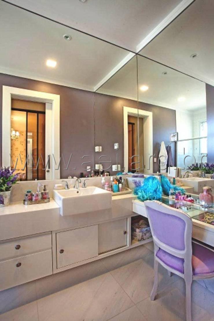 Banheiro de Menina: Banheiros  por aei arquitetura e interiores,