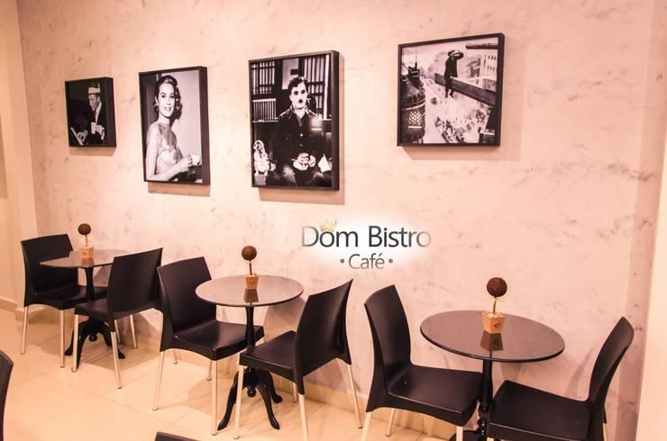 Mesas com artistas detalhes do quado em Artistas: Espaços gastronômicos  por Daniely Victor - Designer de Interiores