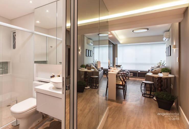 Salas de estilo  por Claudia Stach e Daniela Bordignon Arquitetura
