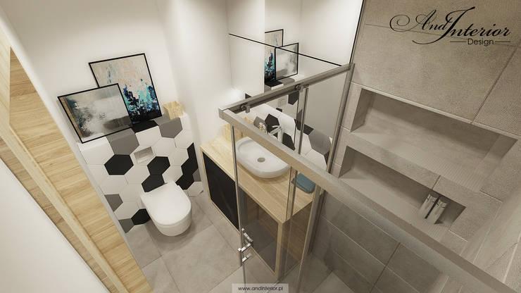 Projekt wnętrza kawalerki na wynajem: styl , w kategorii Łazienka zaprojektowany przez And Interior Design