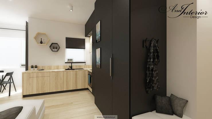 Projekt wnętrza kawalerki na wynajem: styl , w kategorii Kuchnia zaprojektowany przez And Interior Design