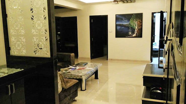 3BHK apartment:  Living room by Interiors By Suniti