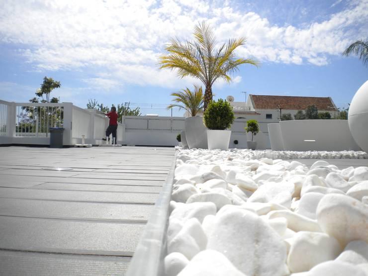 Espaço exterior de condominio fechado: Terraços  por Arqnow, Unipessoal, Lda