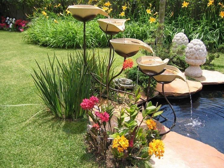 Jardines de estilo rural de Junia Lobo Paisagismo