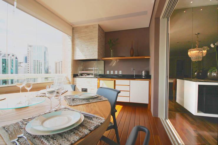 Apartamento Itaim: Terraços  por Officina44