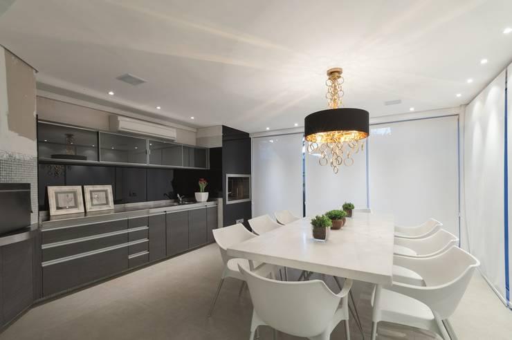 Hall de entrada, Home, Living e Gourmet: Salas de jantar  por Andréa Carvalho Arquitetos Associados