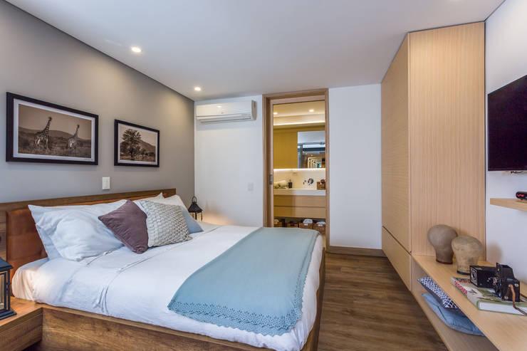 habitación apto 102: Hoteles de estilo  por PLANTA BAJA ESTUDIO DE ARQUITECTURA