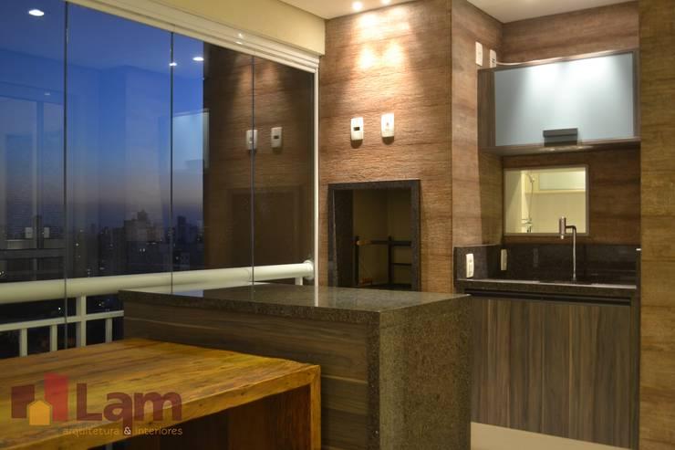 Terraço: Terraços  por LAM Arquitetura | Interiores,