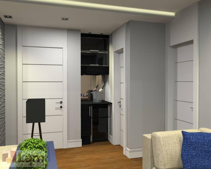 Adega - Projeto:   por LAM Arquitetura | Interiores