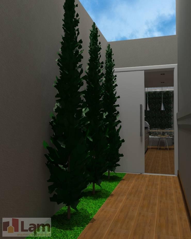 Área Externa - Projeto:   por LAM Arquitetura   Interiores