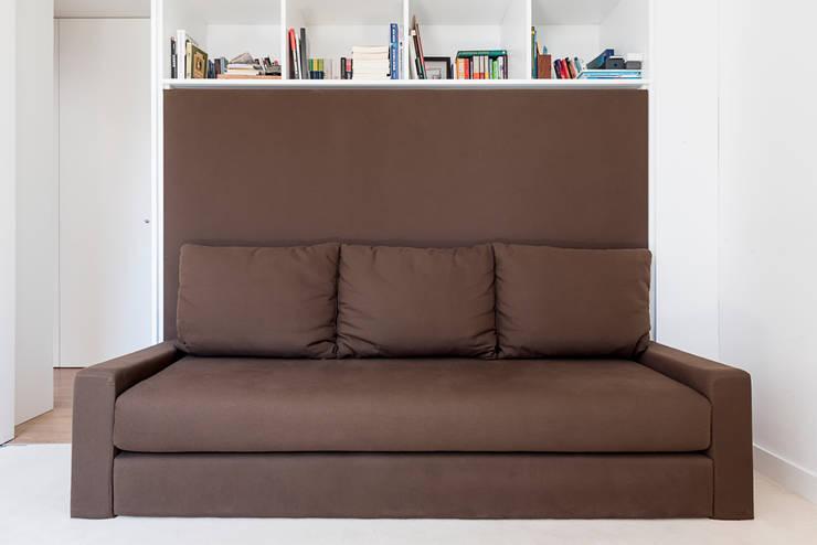 Camera da letto in stile in stile Moderno di Ponto Cúbico