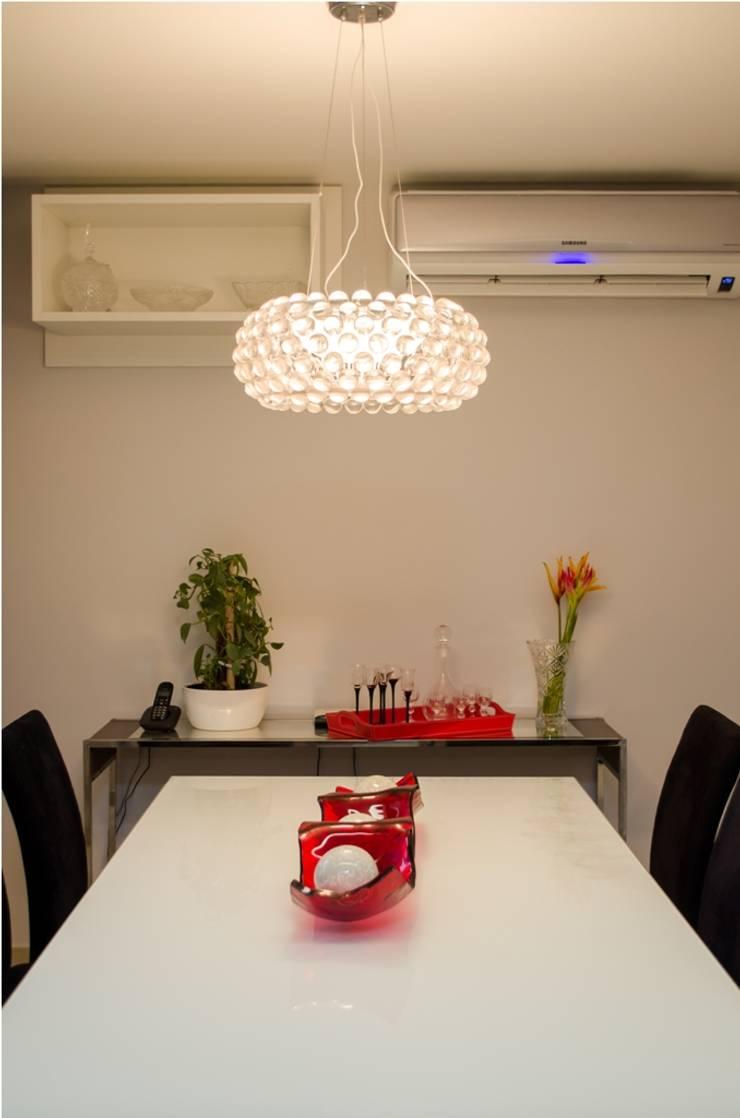 Apartamento Espinheiro: Salas de jantar  por Andressa Rangel Arquitetura e Interiores