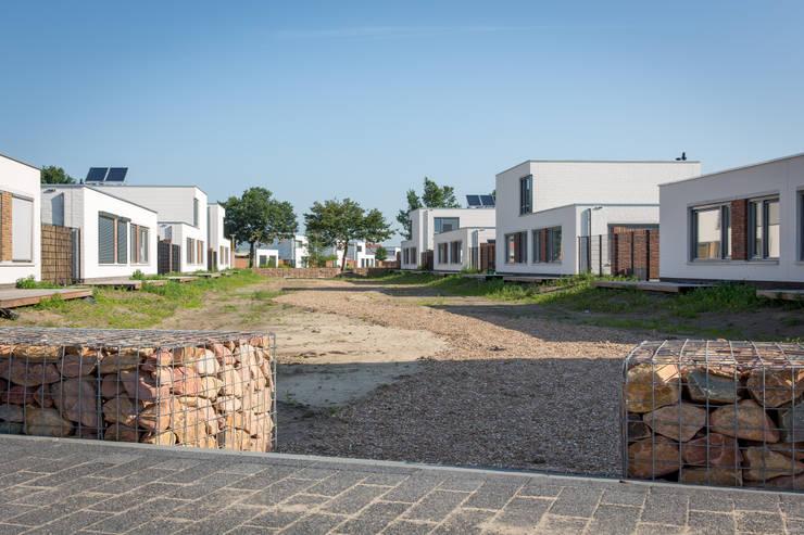Starters patio`s te Oss:  Huizen door Elemans van den Hork Architecten