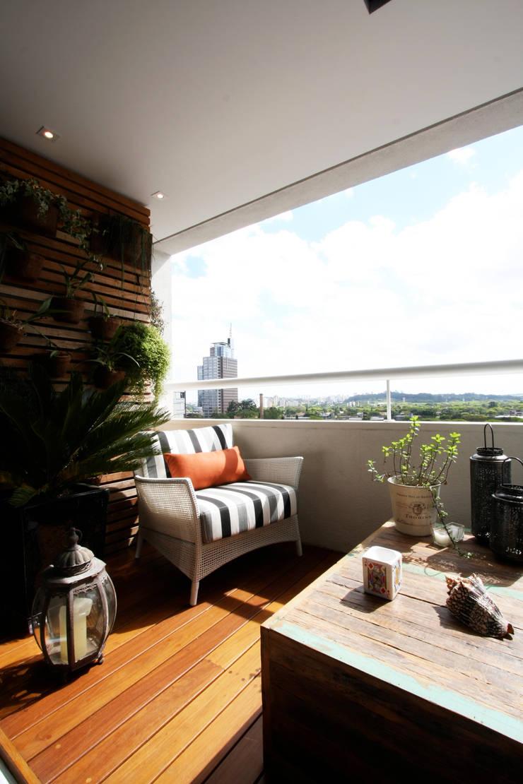 Apartamento Pinheiros 2: Terraços  por Officina44,Moderno