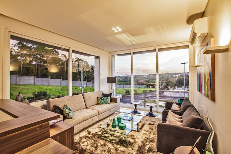 casa rg: Salas de estar  por grupo pr | arquitetura e design