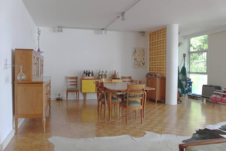 sala de jantar - ap bossa: Salas de jantar  por omnibus arquitetura