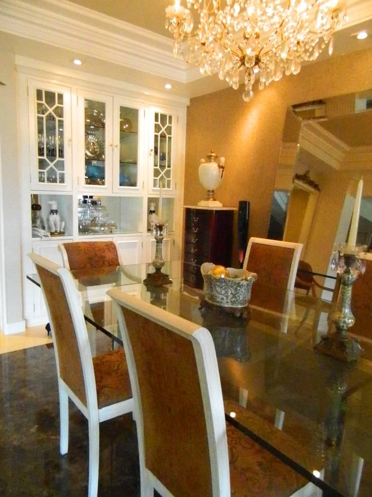 Sala de Jantar: Salas de jantar  por mr maria regina de mello vianna arquitetura e interiores