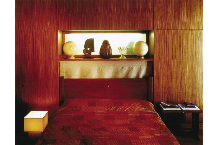 Donizzetti: Camera da letto in stile in stile Minimalista di Spagnulo & Partners