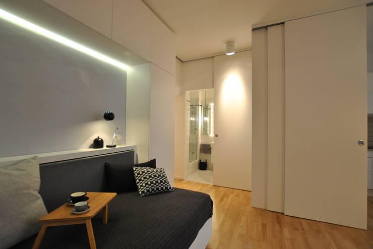 Ferienwohnung:  Wohnzimmer von KJUBiK Innenarchitektur