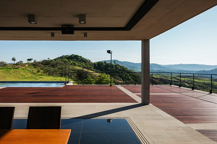 Casa JJ: Salas de jantar  por obra arquitetos ltda