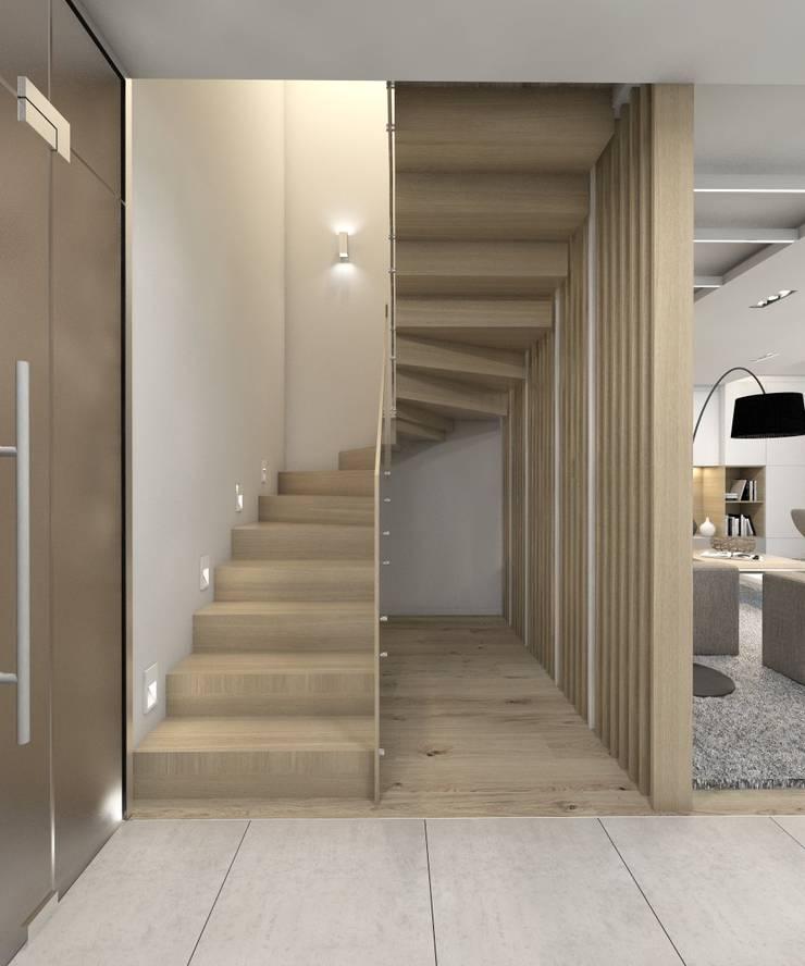 Projekt domu jednorodzinnego 7: styl , w kategorii Korytarz, przedpokój zaprojektowany przez BAGUA Pracownia Architektury Wnętrz,Nowoczesny