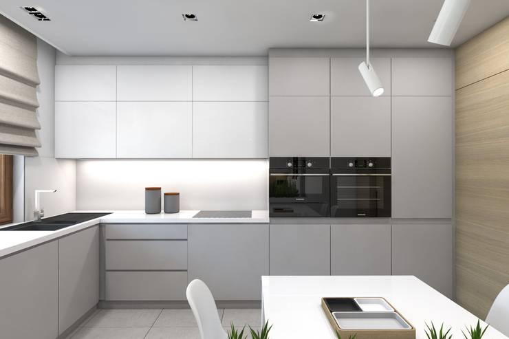 Projekt domu jednorodzinnego 7: styl , w kategorii Kuchnia zaprojektowany przez BAGUA Pracownia Architektury Wnętrz,Nowoczesny