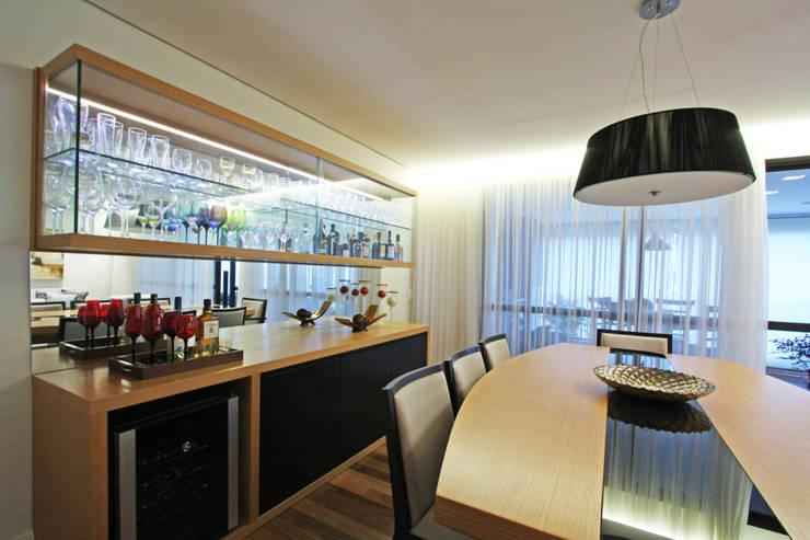 Apartamento Granja Julieta: Salas de jantar  por Officina44