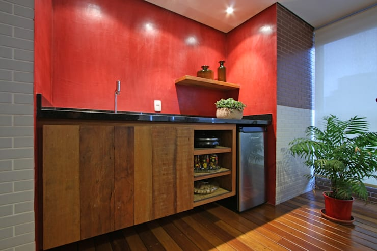 Apartamento Granja Julieta: Terraços  por Officina44