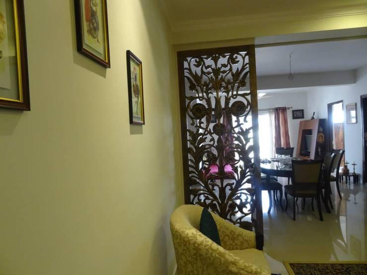 Apartment in NCC Urban Gachibowli.:  Living room by Freelance Designer